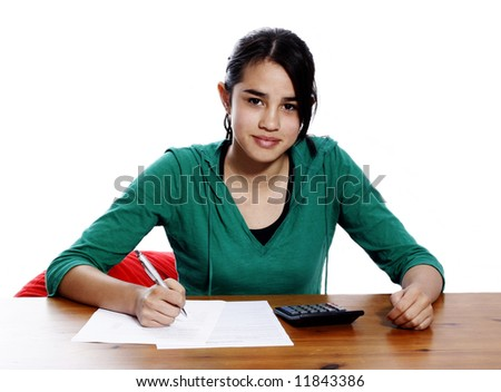 young woman holding a pen, doing her taxes - stock photo