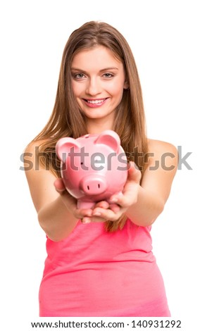 Young woman holding a piggy bank (money box) - savings concept - stock photo
