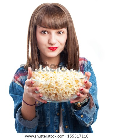 young woman holding a popcorn bowl on white