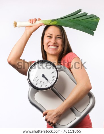 Young woman holding a scale and  fresh vegetable