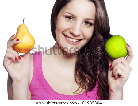 Young woman holding an apple and a pear