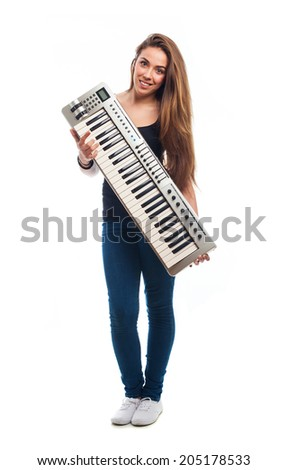 young woman holding an electronic piano over white #205178533