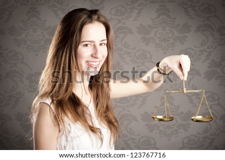 young woman holding an hourglass looking at camera