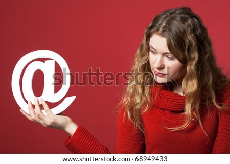 young woman holding an Internet icon