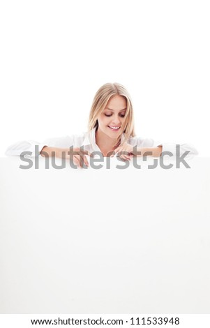 Young woman holding billboard isolated on white background.