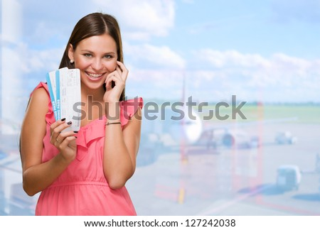 Young Woman Holding Boarding Pass at the airport