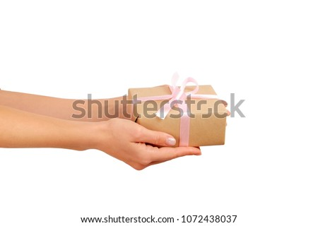 Young woman holding bunch of presents wrapped in hand made blank craft paper gift wrap, satin bow. Female hands, simple giftbox, wrapping, giftwrap, silk ribbon. Blue background, close up, copy space.