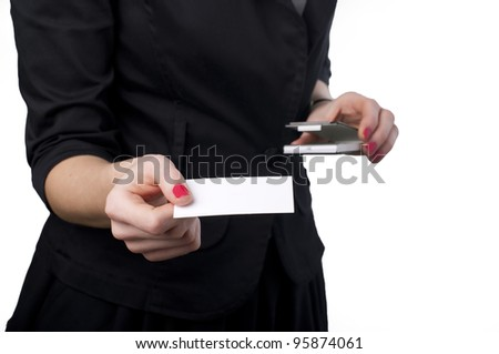 Young woman holding business card isolated on white