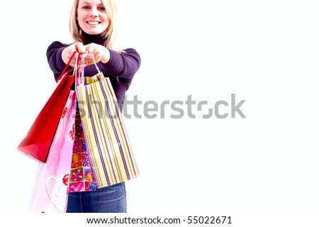 Young woman holding carry bags. Focus on the carry bags. - stock photo