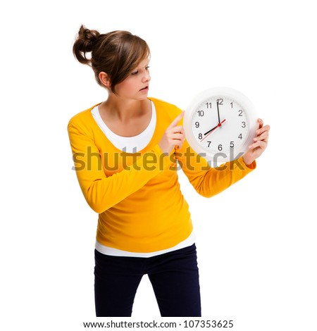 Young woman holding clock isolated on white