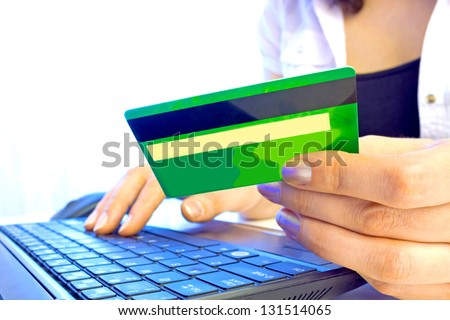 Young woman holding credit card on laptop for online shopping, Credit card, photography