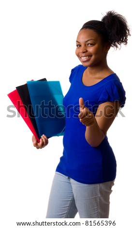 young woman holding folders with her thumbs up.