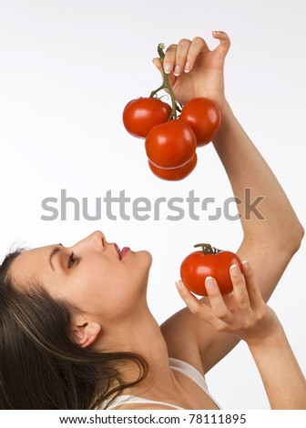 Young woman holding fresh tomatoes - stock photo