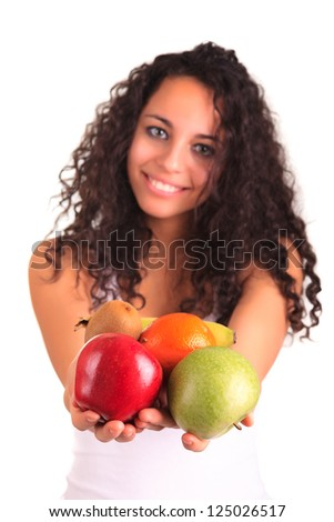 young woman holding fruits. Isolated over white
