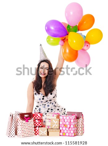 Young woman holding gift box at birthday party.