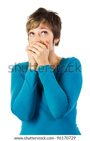 Young woman holding hands over her mouth. Isolated studio shot against a white background. - stock photo