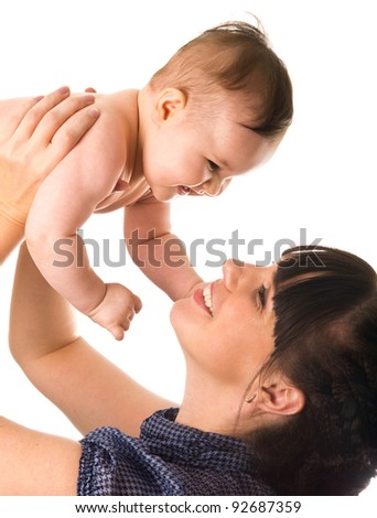 Young woman holding her smiling baby isolated on white