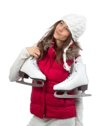 Young woman holding ice skates for winter ice skating sport activity in white hat smiling isolated on a white background