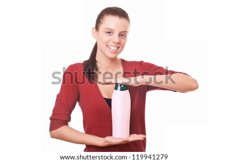 young woman holding in hand blank bottle shampoo
