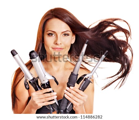 Young woman holding iron curling hair. Isolated.
