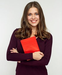 Young woman holding red book. Isolated studio portrait.
