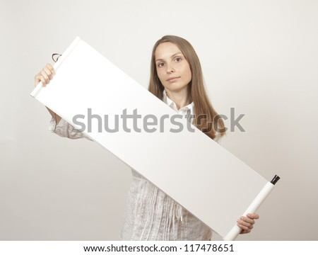 young woman holding scroll paper