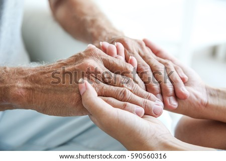 Young woman holding senior man hands, closeup
