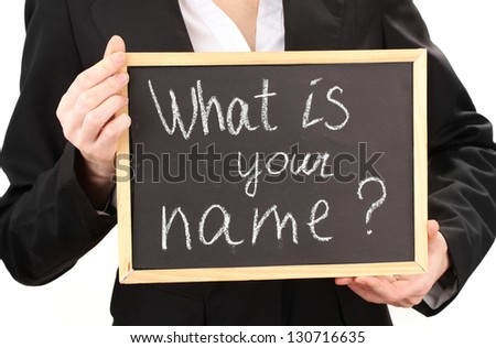 "Young woman holding sign ""What is your name""?"