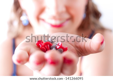 Young woman holding straight pins