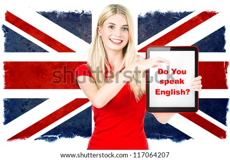 young woman holding tablet pc on the background with british national flag. english language learning concept