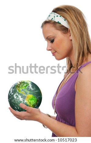 Young woman holding the green earth isolated on white