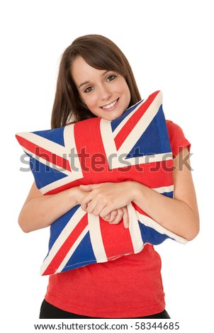 Young woman holding Union Jack cushion