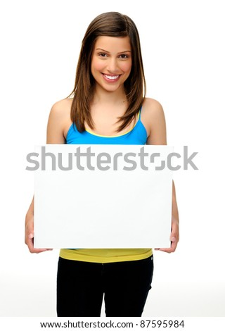 young woman holds a blank board providing copyspace for any advertising. friendly, approachable and smiling