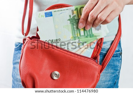 Young woman holds Euro banknotes