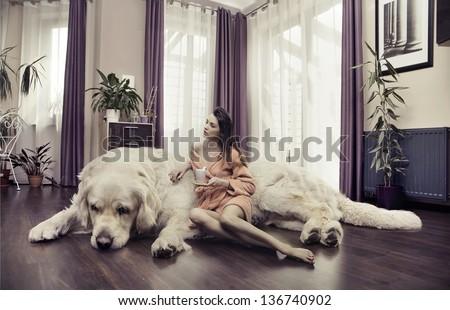 Young Woman Hugging Big Dog