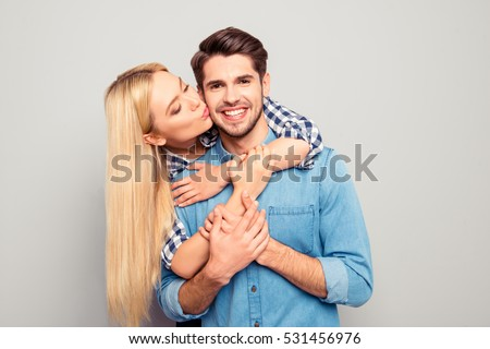 Young woman huging and kissing her handsome smiling husband. #531456976