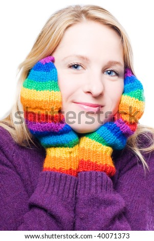 Young woman in a bright colorful gloves