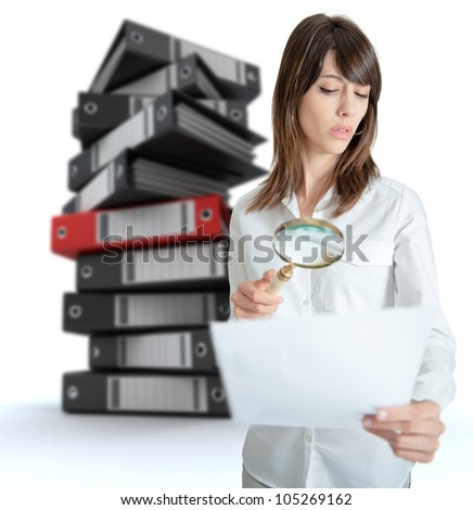 Young woman in a business background analyzing a document with suspicion