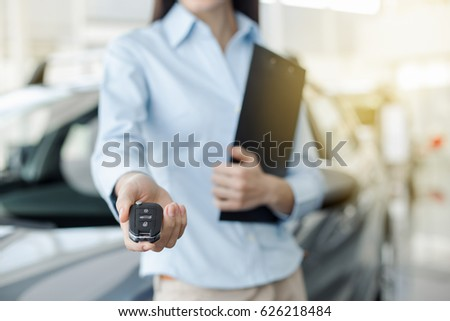 Young Woman in a Car Rental Service Assistant Concept #626218484