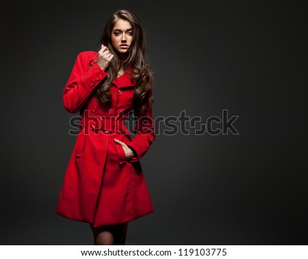 Young woman in a coat for autumn winter fashion - stock photo