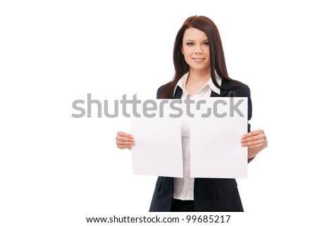 young woman in a jacket and blouse, shows two white sheets, isolated on a white background