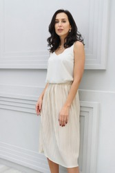 young woman in a posh stylish  dress vintage on a white background isolate