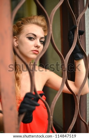 young woman in a prison cell