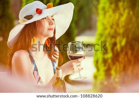 Young woman in a restaurant with wineglasess