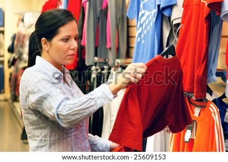 Young woman in a textile market with clothing