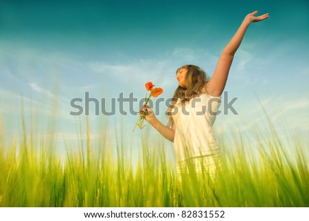 Young woman in a wheat
