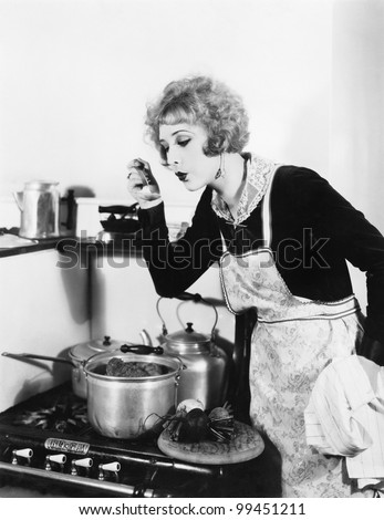 young woman in an apron in her...