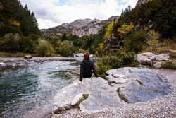 Young woman in autumn in Bujaruelo, Ordesa and Monte Perdido National Park, Spain