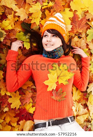 Young woman in autumn orange leaves. Outdoor. #57952216