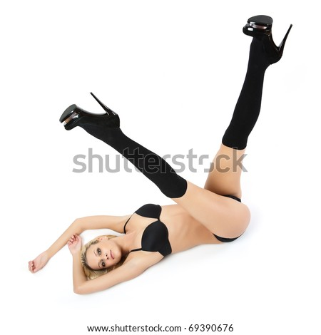 Young woman in black panties, bra and shoes.